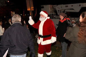 Santa arrives at the tree lighting courtesy of the TTD bucket truck.